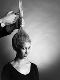 Artistic haircut. Monochrome vertical image of young woman´s reaction to a haircut Royalty Free Stock Photo