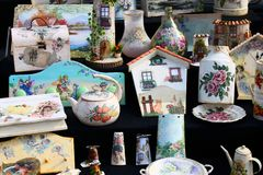 Artistic hand-painted tiles. For sale antique market Royalty Free Stock Photography