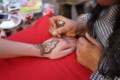 Henna painting design on hand stock photography
