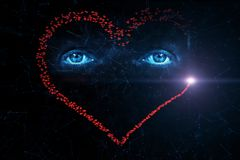 Artistic human eyes with big red heart shape background. stock images