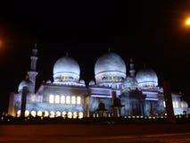 Artistic illumination of beautiful white stone Mosque in Abu Dhabi Royalty Free Stock Photos