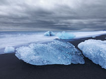 Artistic image of blocks of ice by the sea Stock Photography