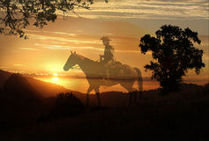 An artistic image of a cowboy riding in a meadow with trees and a transparent yellow sunet background. A cowboy riding his horse in the mountains with a Royalty Free Stock Photo