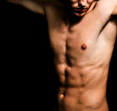 Artistic image of muscular sexy man body. Over black Royalty Free Stock Photography