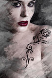 Artistic image of tattooed woman with a flower tattoo black trib Royalty Free Stock Images