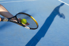 Artistic image, tennis player no face preparing to serve Stock Photography