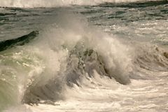 ARTISTIC EFFECT ADDED TO CRESTING WAVE royalty free stock photography