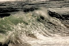 ARTISTIC IMAGE OF BREAKING WAVE stock photo