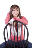 Artistic Image of a Woman Sitting on a Chair Stock Photos