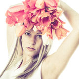Artistic image of young woman holding flowers. Above he head. square Royalty Free Stock Image