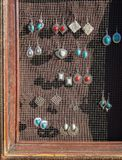 Artistic jewelry for sale. Earrings with a Southwestern design for sale Royalty Free Stock Photo