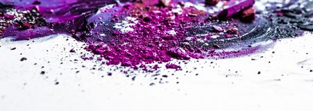 Artistic lipstick smudge and crushed eyeshadow as background. Beauty texture, cosmetic product and art of make-up concept - Artistic lipstick smudge and crushed stock photography