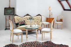 Artistic Living Room. A living room arrangement with furniture reminiscent of the 1800s. A leopard skin rug is in the foreground stock images