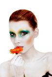 Artistic make-up. Woman with an artistic make-up holding flower Stock Photography