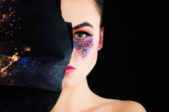 Artistic Makeup. Beautiful Female Face with Art Make-up. Black Background stock image