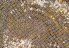 Abstract Background Gold and Black Mirrored Elements. Artistic mirror made of gold and smoke glass pieces creating a symmetric background with a moon like royalty free stock photos