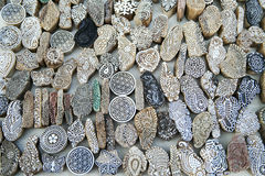 Artistic mold pieces etched in stone displayed near Gadisar Lake. In Jaisalmer, Rajasthan, India, Asia. Selective focus for DOF stock photo