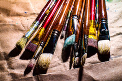 Artistic paintbrushes on board. The means of self-expression Stock Image