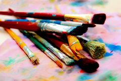 Artistic paintbrushes and palette - colorful world. Wonderful diverse world. Self-expression and artistic freedom Stock Photography