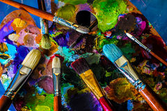 Artistic paintbrushes and palette. Wonderful diverse world. Self-expression and artistic freedom Royalty Free Stock Photography