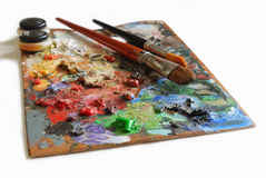 Artistic palette. Artistic color pallete and brushes on white background Stock Photo