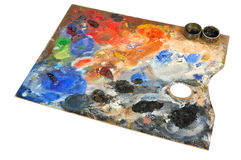 Artistic palette. Covered with colors on white background Stock Photo