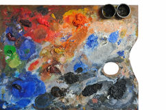 Artistic palette. Covered with colors on white background Stock Images