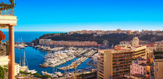 Artistic panoramic view o Monte Carlo`s harbour. Unusual aerial image of the port of Monaco and the Rocher showing the city`s modern architecture Royalty Free Stock Photos