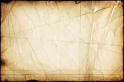 Artistic paper background. Retro artistic paper background with many folds, cuts, dark borders, stains. Fine artistic texture stitched with sticky tape Royalty Free Stock Photos