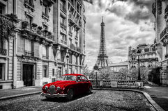 Artistic Paris, France. Eiffel Tower seen from the street with red retro limousine car. Black and white unique vintage composition