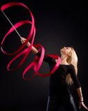 Artistic photo of rhytmic gymnast with ribbon Stock Images