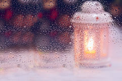 Artistic photo of a wet glass Christmas candle Royalty Free Stock Images