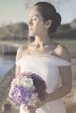 Artistic picture of bride in wedding gown Royalty Free Stock Photos