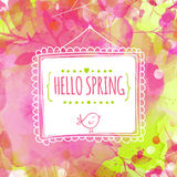 Artistic pink and green background with watercolor texture and leaves traces. Hanging hand drawn square frame with text hello spri Royalty Free Stock Image