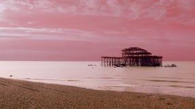 Artistic pink pier in Brighton stock photos
