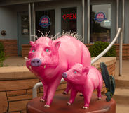 Artistic pink pigs in front of a tour business in sedona Stock Photography