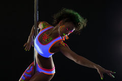 Artistic pole dancer with neon pattern on body Stock Images