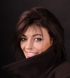 Portrait of brunette on a dark Royalty Free Stock Photos