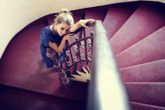 Artistic portrait of elegant woman on stairs. Artistic portrait of elegant woman on circular stairway royalty free stock photo