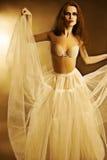 Artistic portrait of elegant woman in white skirt royalty free stock photo