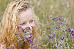 Artistic portrait of freckled woman on natural background Royalty Free Stock Image
