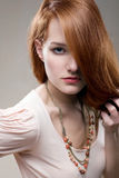 Artistic portrait of gorgeous young redhead. Stock Photo