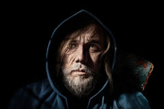Artistic portrait old man, of mysterious  wanderer in the hood Stock Photo
