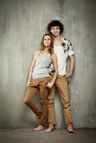 Artistic portrait of a young couple. On a gray, textural background Stock Image