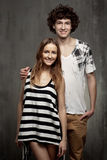 Artistic portrait of a young couple on a gray. Textural background Stock Photo