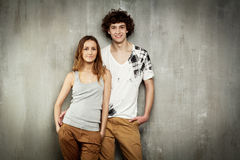 Artistic portrait of a young couple on a gray. Textural background Royalty Free Stock Images