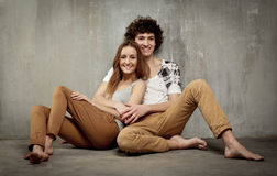 Artistic portrait of a young couple on a gray Stock Photo