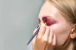 Artistic professional make up applies eye shadow. Beautiful woman face Royalty Free Stock Image