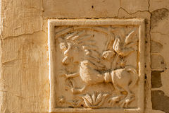 Artistic relief on preserved old wall Royalty Free Stock Images