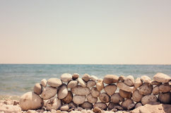 Artistic rock wall on a sandy beach Royalty Free Stock Image